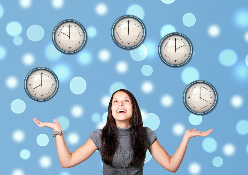 Girl juggling clock 'balls'